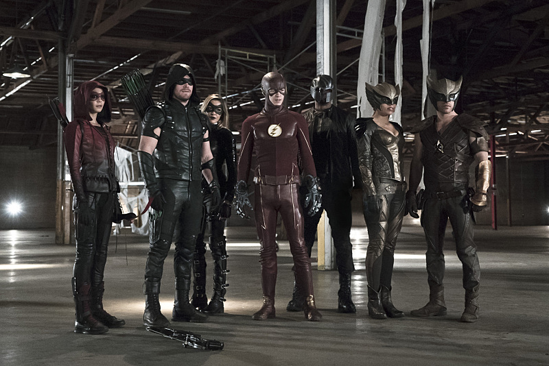 """Arrow -- """"Legends of Yesterday"""" -- Image AR408B_0379b.jpg -- Pictured (L-R): Willa Holland as Speedy, Stephen Amell as The Arrow, Katie Cassidy as Black Canary, Grant Gustin as The Flash, David Ramsey as John Diggle, Ciara Renee as Hawkgirl and Falk Hentschel as Hawkman -- Photo: Katie Yu/ The CW -- © 2015 The CW Network, LLC. All Rights Reserved."""